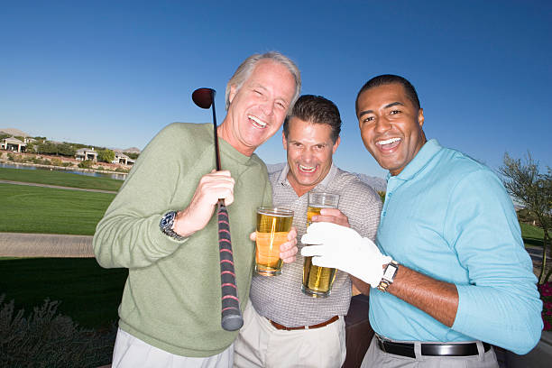 Three men enjoying a beer while playing golf